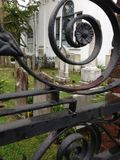 Gates of Charleston 4. Ironwork gate and scroll detail enclosing a cemetery royalty free stock photo