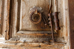 Gates of the Church of the Holy Sepulchre in Jerusalem. Ancient door handle of wooden gates at the entrance to the Church of the Holy Sepulchre in Jerusalem on royalty free stock image