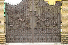 Gates into the courtyard, Gate view from the street, Forged gate Royalty Free Stock Photo