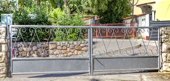 Gates and Driveway. Of a Country Estate Royalty Free Stock Photo