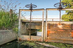 Gates of irrigation channel Stock Images