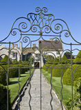 Through the gates at Lytes Cary. The iron gates at Lytes cary Manor house in Somerset Stock Image