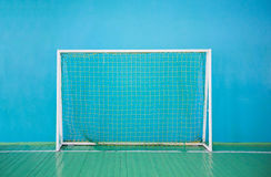Gates for mini-football on the background of blue wall Stock Image
