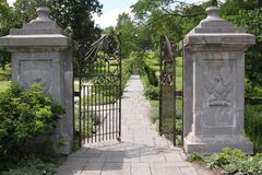 The gates are open. These gates are the beginning of the long walk up to a beautiful country estate Royalty Free Stock Photos