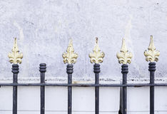 Gates painted metallic gold Royalty Free Stock Image