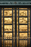 Gates of Paradise with Bible, Florence. Gates of Paradise with Bible stories on door panels of Duomo Baptistry, Florence, Italy Royalty Free Stock Photography