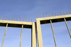 Gates with prickles. Abstract gates with prickles on the blue sky stock photography