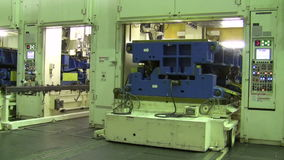 The gates of the stamping lines are opened and replaced by a punch press machine stock video footage
