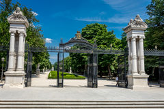 Gates to central park in the city of Madrid in Spain, Europe. On a clear sunny day with blue skies Stock Image