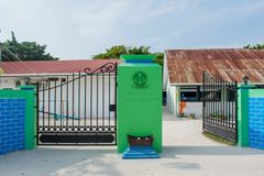 Gates to the school in the village at the local island Maamigili. In Maldives stock images