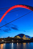 Gateshead Evening. The image shows the Gateshead Millennium Bridge in the foreground with the Sage concert and musical education centre in the background.  The Stock Photos
