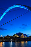 Gateshead Evening. The image shows the Gateshead Millennium Bridge in the foreground with the Sage concert and musical education centre in the background.  The Royalty Free Stock Photos
