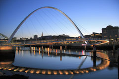 Gateshead Millennium Bridge. Spanning the River Tyne. Viewed from Gateshead towards Newcastle upon Tyne. Made of two arches - the upper arch supports the other Stock Photo