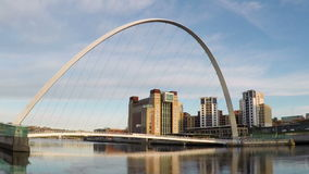 Gateshead Millennium Bridge and the Baltic Centre. A timelapse recording of Gateshead Millennium Bridge and the Baltic Centre.  The bridge spans the River Tyne stock video footage