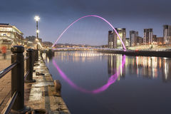 Gateshead Millennium Bridge. From Newcastle Quayside showing the illumination of the bridge with reflections in the River Tyne Stock Images