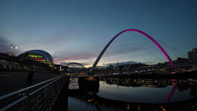 Gateshead Millennium Bridge. A timelapse recording of dusk over the Gateshead Millennium Bridge.  In the background is the music venue the Sage and the Tyne stock video footage