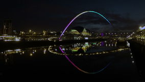 Gateshead Millennium Bridge. A timelapse recording of dusk over the Gateshead Millennium Bridge.  In the background is the music venue the Sage and the Tyne stock footage