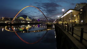 Gateshead Millennium Bridge. A timelapse recording of the Gateshead Millennium Bridge in the foreground with the Sage and the Tyne Bridge in the background stock video