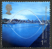 Gateshead Millennium Bridge UK Postage Stamp. GREAT BRITAIN - CIRCA 2000: A used postage stamp from the UK, celelbrating the Ordnance Survey Map, circa 2000 stock images