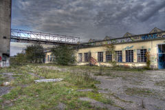 Gateway in an abandoned textile company. Closed textil factory waiting for destruction Stock Image