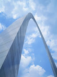 Gateway Arch. Looking up to the towering St. Louis Gateway Arch against a blue sky with fluffy white clouds Stock Photography