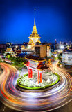 The gateway arch (Odeon Circle) and Traimit temple behind with l. Ight trails from long exposure photo taken, Landmark of Chinatown Bangkok Thailand. (Chinese Stock Photography