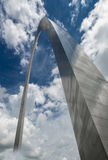 Gateway Arch in Saint Louis Missouri. Fantasy view of a metal arch rising above the clouds as if a gateway to heaven Royalty Free Stock Photography