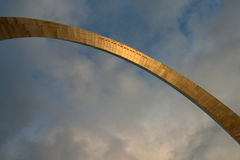 Gateway Arch in St. Louis. The St. Louis Gateway Arch illuminated by the sunset against a blue sky with clouds Stock Image