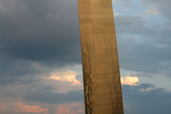 Gateway Arch in St. Louis. The St. Louis Gateway Arch illuminated by the sunset against a sky with clouds Stock Photo
