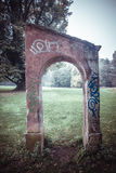 Gateway in autumn park landscape Royalty Free Stock Image