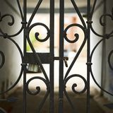 Gateway behind the wrought-iron gates fragment Royalty Free Stock Photo