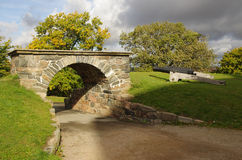 Gateway and cannon. One of the king's gateways to Skansen Kronan, the castle on the hill above Gothernburg, Sweden. Next to the gateway is one of the castle's royalty free stock photography