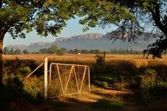 Gateway. Farm Gate Below Magaliesberg Mountains Royalty Free Stock Photography