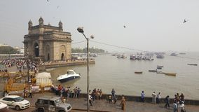 Promonade of Gateway of India, Mumbai. The Gateway of India is an arch monument built during the 20th century in Bombay, India. The monument was erected to Stock Image