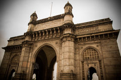 Gateway of India. The Gateway of India is a monument built during the British Raj in Mumbai (formerly Bombay), India. It is located on the waterfront in the Royalty Free Stock Photo