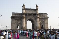 Gateway of India, Mumbai. National Monument surrounded by hundreds of people dressed in traditional costumes stock images