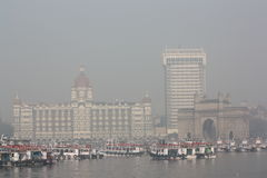 Gateway of India and Taj Mahal Palace Hotel. Mumbai/Bombay harbour view of the gateway of India and Taj Mahal Palace Hotel in smog Stock Image