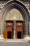 Gateway and porch of Chambery's cathedral. Wooden gateways and porch of cathedral Notre Dame in Chambery, France Stock Image
