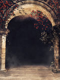 Gateway with roses and vines. Gothic entrance to a corridor with red roses, vines, and fog Stock Photography