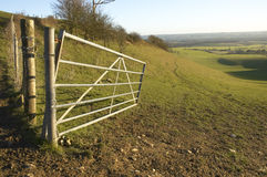Gateway to the countryside. A gate leading to a valley in the countryside Stock Image