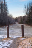 Gateway to Gravel Road. Two pipes mark the gateway to a rural gravel road Royalty Free Stock Photography