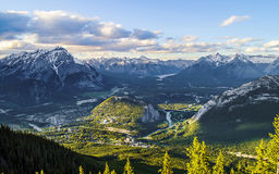 Gateway to Heaven. The setting Sun casting golden rays on the town of Banff in Alberta, Canada. I took this from Sulphur Mountain in Spring 2012 Stock Image