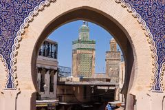 Gateway to the medina, in the background minaret, Fez, Morocco Stock Image