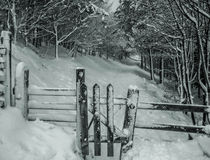 Gateway to nowhere. Black and White Snowy scene photo taken in the Peak District Stock Image