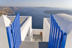Gateway to Santorini, Greece. Gateway to a hotel in Santorini, Greece, with a cruise ship in the background royalty free stock image