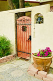 Gateway to Spanish courtyard. A decorative entrance with ornate gate and bell to a Spanish-style walled courtyard in New Mexico Royalty Free Stock Image