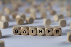 Gather - cube with letters, sign with wooden cubes. Series of images: cube with letters, sign with wooden cubes stock image