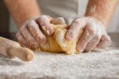 Gather dough together to form ball. Making Apple Pie Tart royalty free stock photo