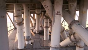 Gather of white tubes. Abstract columns and pipes outdoor stock video footage