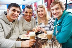 Gathered in cafe Royalty Free Stock Image